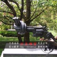 玻璃钢仿铜仿真扭曲打结手枪雕塑拒绝战争和平象征广场公园林摆件
