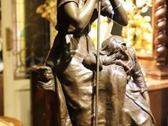 签名铸铜雕塑——《劳作歇息的少女》